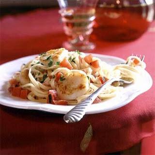 Pan-Seared Scallops on Linguine with Tomato-Cream Sauce.