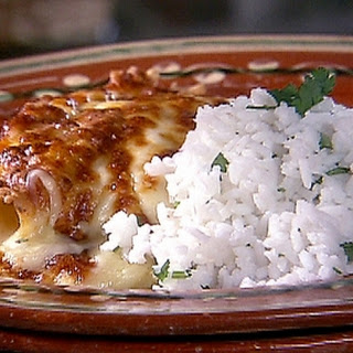 Chicken Enchiladas With Green Sauce And Long-grain Rice.