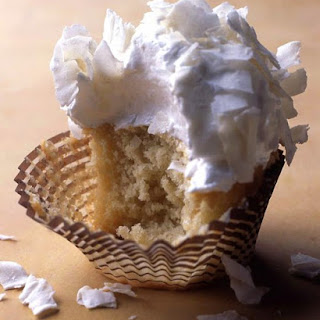 Coconut Cupcakes with Seven-Minute Frosting and Coconut Flakes.