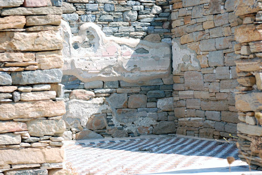 wall-delos-greece - A wall of a residence on Delos, Greece. The abandoned island is one of the major mythological, historical and archaeological sites in Greece.