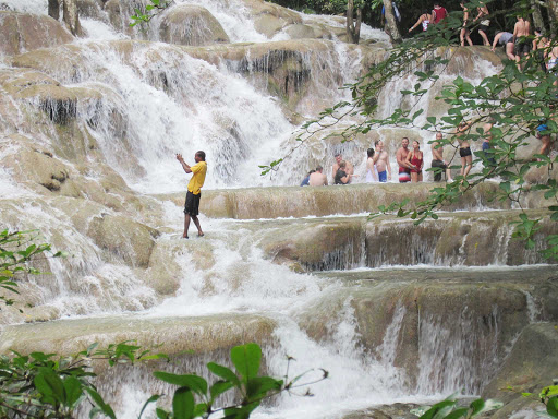 Day trippers line up at Dunn's River Falls near Ocho Rios, Jamaica.