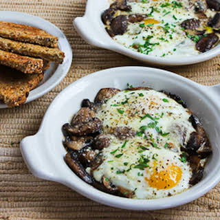 Baked Eggs with Mushrooms and Parmesan.