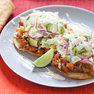 Chorizo Tostadas with Pickled Red Onions, Lime Crema & Queso Fresco.