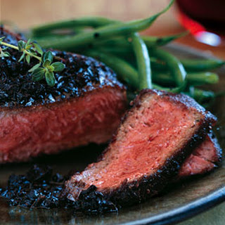 Black-Pepper-Crusted Wagyu New York Steaks with Black Truffle Vinaigrette