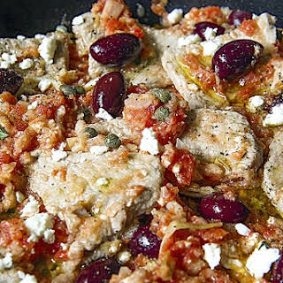 GREEK VEAL SCALOPPINE with fresh tomato pulp, feta cheese and kalamata olives.