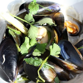 Coconutty Mussels with Ginger, Lemongrass, Chili, and Cilantro on Rice Noodles