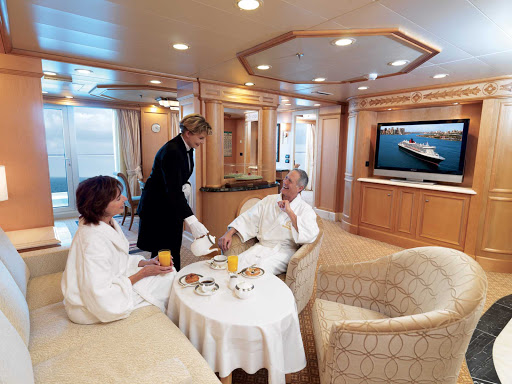 You'll have room to relax in the Master Suite aboard Queen Victoria with its large living area, floor-to-ceiling windows, furnished private balcony, king bed and more.