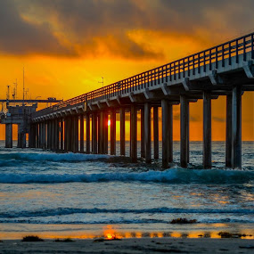 Behind the Pier by Lance Emerson - Buildings & Architecture Bridges & Suspended Structures ( clouds, water, sand, scripps pier, sunset, pier, ocean, beach, la jolla, storm, stormy, weather,  )