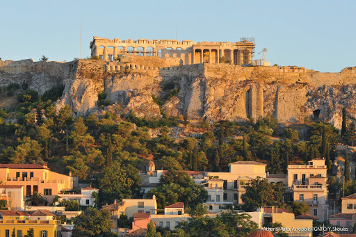 The Plaka, the most desired area of Athens, shows off its neoclassical side at sunset on the north slope of the Acropolis.