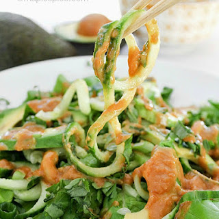 Cucumber Noodle Salad with Avocado and a Spicy Cashew Butter Dressing.