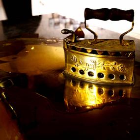 Grandma's Flat Iron by Rodolfo Dela Cruz - Artistic Objects Antiques ( artistic, object, gold, antique, iron )