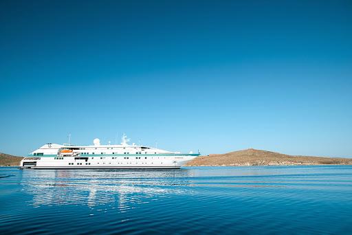 Tere-Moana-in-Delos-2 - Paul Gauguin Cruises' Tere Moana anchored off the historic island of Delos, Greece.