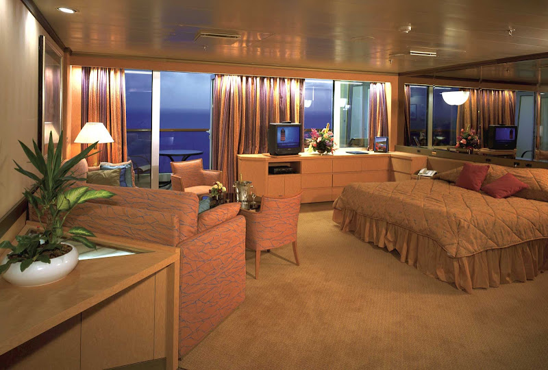 Relax in this cozy Neptune Suite aboard Holland America Line's Volendam.