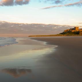 Bamburgh Beach by John Ash - Landscapes Beaches ( sand, reflection, northumberland, castle, beach, bamburgh beach, evening )