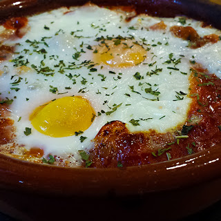 Baked Egg in Tomato with Chestnut Mushrooms and Black Olives