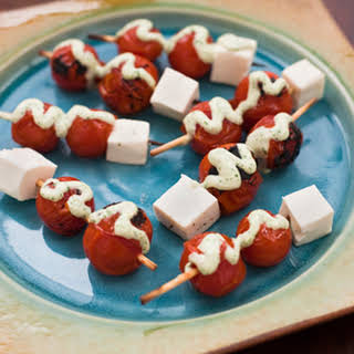 Broiled Cherry Tomato Skewers with Basil Dressing.