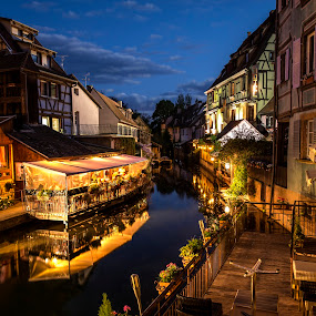 Petite Venise By Night by Lillian Molstad Andresen - City,  Street & Park  Night ( half timbered houses, colmar city, reflections, architecture, landscape, city, lights, sky, nature, watercanal, france, flowers, evening, restaurants, balcony, clouds, water, houses, windows, terrasse, canal, roofs, night, river, colmar, , Urban, City, Lifestyle )