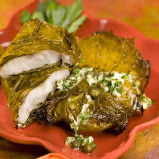 Red Snapper in Grape Leaves with Garlic and Caper butter.