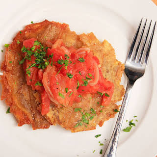 Patacones Con Hogao (Colombian-style Fried Plantains with Tomato-onion Sauce).