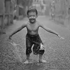Dancing In The Rain by Agung Wicaksono - Babies & Children Children Candids ( water, child, potrait, dancing, children, candid, kids, people, rain,  )