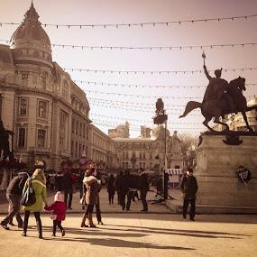Sunny day in Bucharest by Matei Edu - City,  Street & Park  Street Scenes ( iphone4s, bucharest, christmas, market, universitysquare, people, children, photography, sky, blue, statues, buildings, history, architecture, shadows, ig_romania, visit_bucharest, visit_romania, vignette, relax )