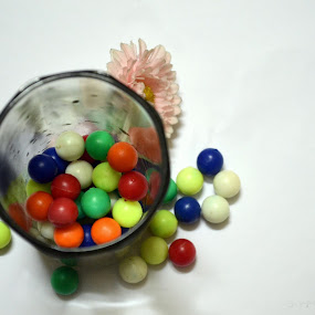 colors  by Bhaskar Kalita - Artistic Objects Other Objects ( balls, colorful, colors, glass, white background, flowers )