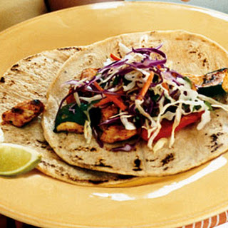 Spice-Rubbed Chicken and Vegetable Tacos with Cilantro Slaw and Chipotle Cream.