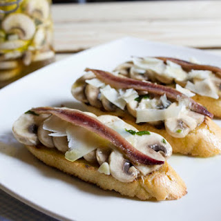Marinated Mushroom Crudites with Anchovies and Aged Cheese.