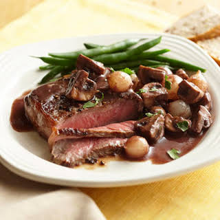 Beef with Mushrooms and Pearl Onions in Red Wine Reduction.