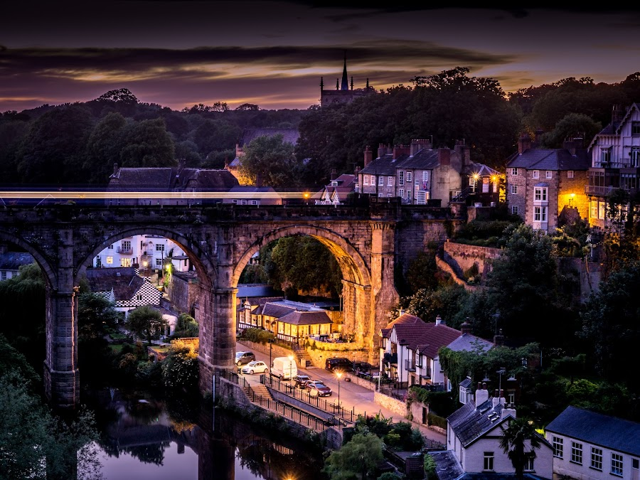 Speeding over the bridge-Knaresborough, UK by Donna Brittain - City,  Street & Park  Night ( purple, cityscape, yellow, city, lights, urban, village, yorkshire, color, lifestyle, train, night, bridge, night sky, knaresborough. uk )
