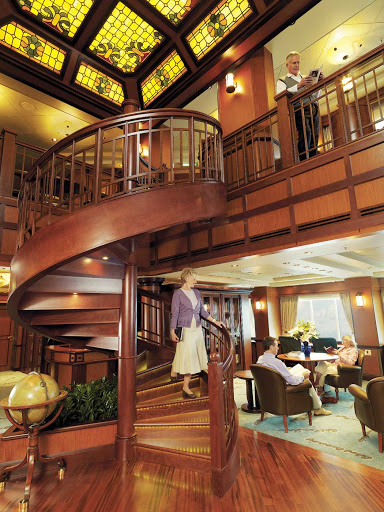 Cunard-Queen-Victoria-Library - Bibliophiles, get thee to the library aboard Queen Victoria, where you'll find a quiet atmosphere for browsing a selection of more than 6,000 works.