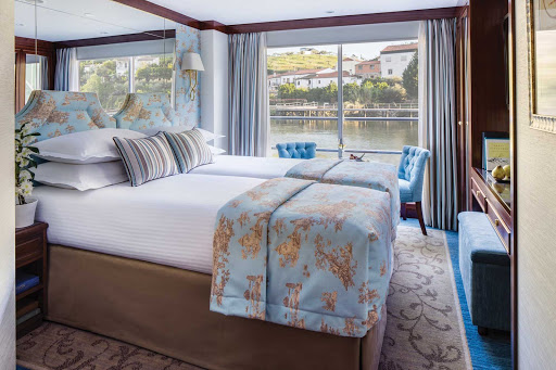 The comfortable staterooms aboard Uniworld's cruise ship Queen Isabel offer the luxury of space and uninterrupted views of the passing landscapes.