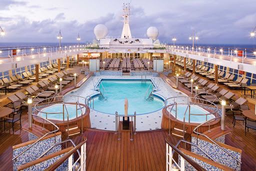 Regent-Seven-Seas-Voyager-Pool-Deck - Seven Seas Voyager's expansive pool deck is a great place to kick back, read and enjoy the beautiful weather and scenery.