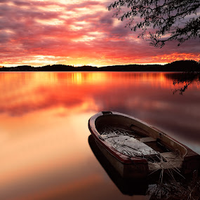 Fire over lake by Basri Ahmedov - Landscapes Sunsets & Sunrises ( canon, water, cold, sunset, lake, boat, fire )