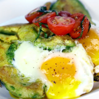 Michael Symon's Eggs in Avocado with Tomato and Basil.