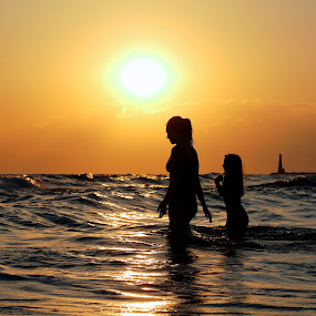 One last dip by Jeremy Church - Landscapes Beaches ( water, michigan, lake michigan, muskegon, sunset, lighthouse, kids )