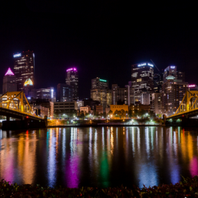 A Tale of Two Bridges by Michael Sharp - Buildings & Architecture Bridges & Suspended Structures ( reflection, skyline, pennsylvania, united states, allegheny county, city, allegheny river, pittsburgh, pa, buildings, night, bridge, rachel carson, andy warhol, river,  )