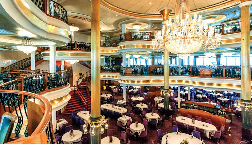 Adventure-of-the-Seas-Main-Dining-1 - The impressive three-deck main dining room on Adventure of the Seas offers a variety of menu options for breakfast, lunch and dinner.