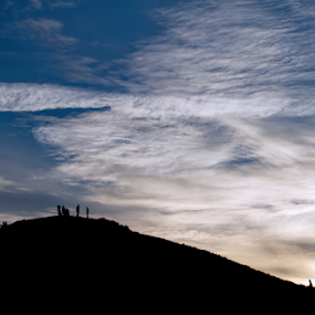 Twin Peaks Sunset Lurkers by Doug Redding - Landscapes Mountains & Hills ( hills, silhouette, sunset, people, san francisco, sunset silhouette,  )