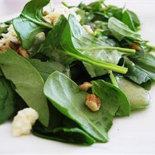Spinach salad with Roquefort and walnuts.