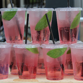 Pink drink to quench thirst by Judith Dueck - Food & Drink Alcohol & Drinks ( tropical environment, plastic, straw, colorful, quench, carbonated, refreshing, fluid, cold, ice, drink, glass, cocktail, pink, soft drinks, transparent, water, cool, fruit, flavor, mint, juices, lime, delicious, soda, thirst, row, tasty, sweet, liquid, fruit juice, pattern, beverage, food, alcohol, thirsty, background, lemon )