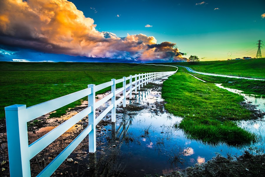 by Becca McKinnon - Landscapes Prairies, Meadows & Fields ( clouds, story, fence, reflection, winding road, california, sunset, redding, millville, millville plains, relax, tranquil, relaxing, tranquility )