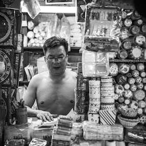 Life in a box by Callum Harris - People Street & Candids ( old, market, frustrated, store, black and white, andry, vietnam, man, emotion,  )