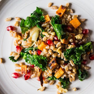 Farro with Roasted Sweet Potato, Kale and Pomegranate Seeds.