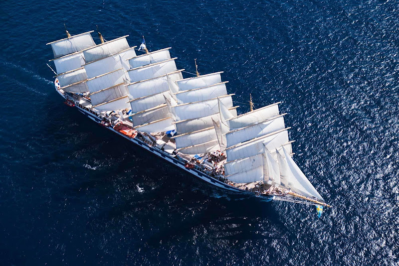 Feel the wind fill the sails of Royal Clipper during the sailing in the Caribbean. The ship switches on its engines now and then but mostly relies on wind power.