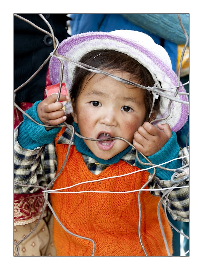 Leh by Diego Scaglione - Babies & Children Child Portraits ( looking, child, eating, baby, hat,  )