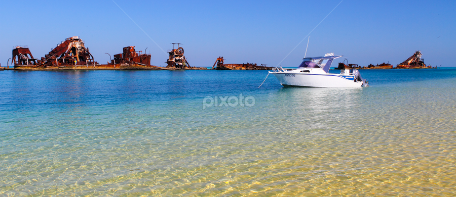 Serenity by Howard Ferrier - Landscapes Beaches ( tangalooma, sand, reef, moreton bay, blue, shipwreck, moreton island, beach, rust, cabin cruiser, panorama, landscape,  )