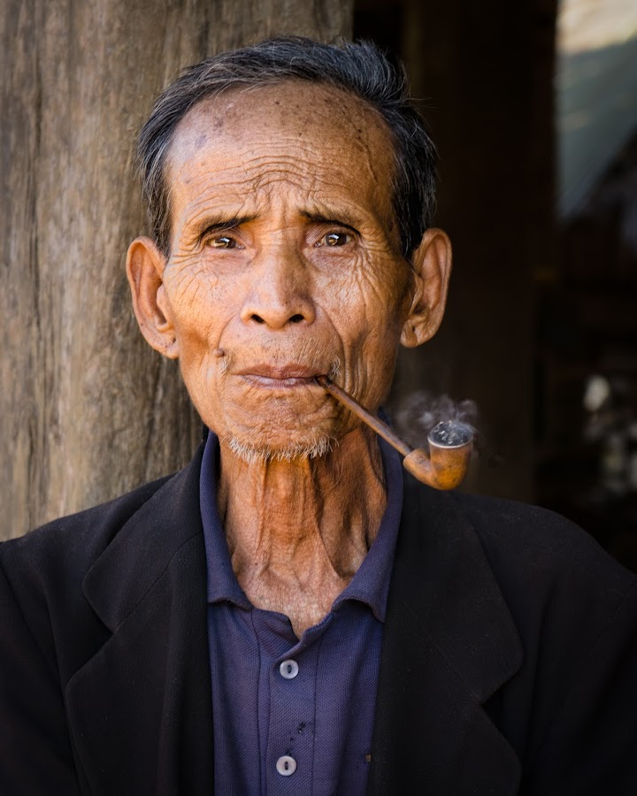 The Pipe by Nancy Arehart - People Portraits of Men ( thailand, old man, smoke, pipe,  )