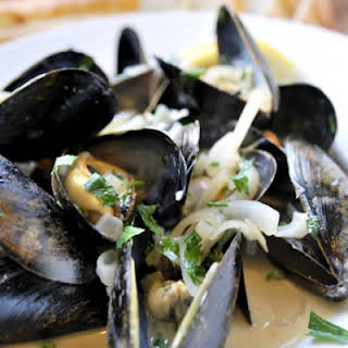 Steamed Mussels in White Wine Broth.