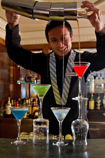 Azamara-Martini-Bar-bartender - Watch the bartender create one of 20 variations of martini in the sophisticated Martini Bar on your Azamara cruise.